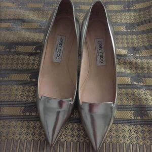 Authentic Jimmy Choo silver allure kitten heels.